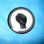 "An original ""protest"" button from the 60's. Black clenched fist"